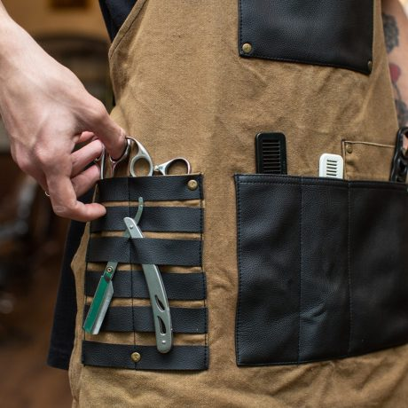 barber with various tools in his pockets